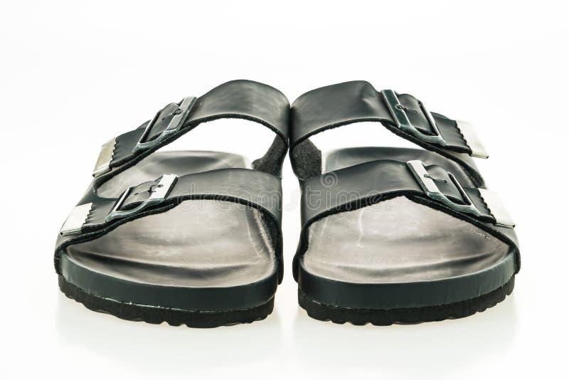 Zapatos de cuero de la sandalia y de la chancleta de los hombres foto de archivo
