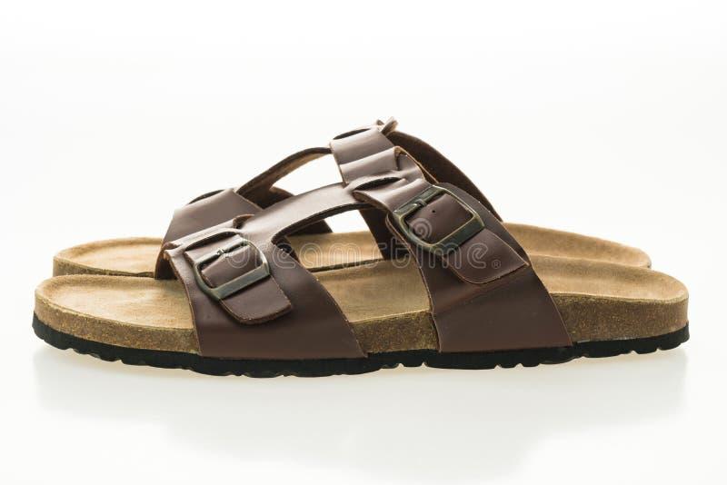 Zapatos de cuero de la sandalia y de la chancleta de los hombres fotos de archivo
