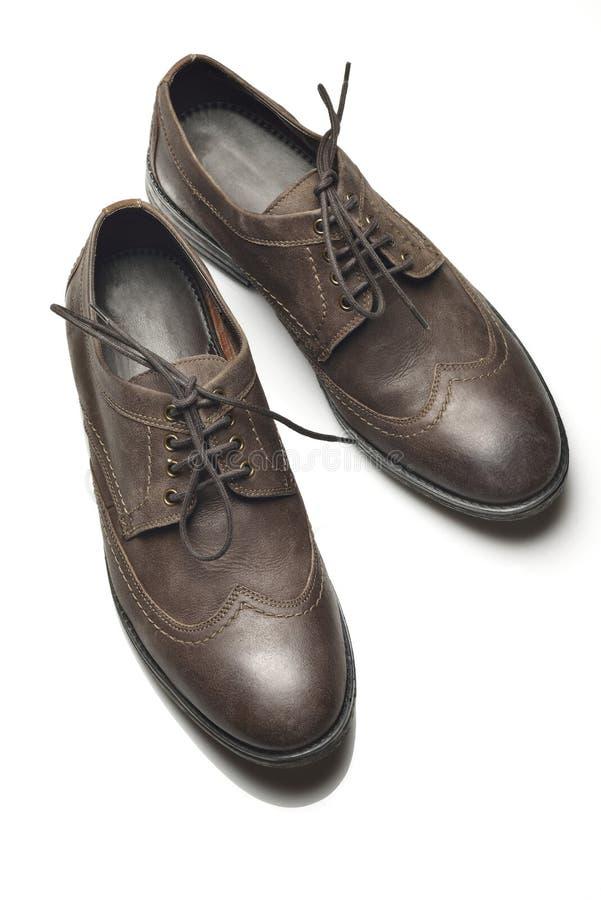 Zapatos de cuero del ` s de los hombres en el fondo blanco imágenes de archivo libres de regalías