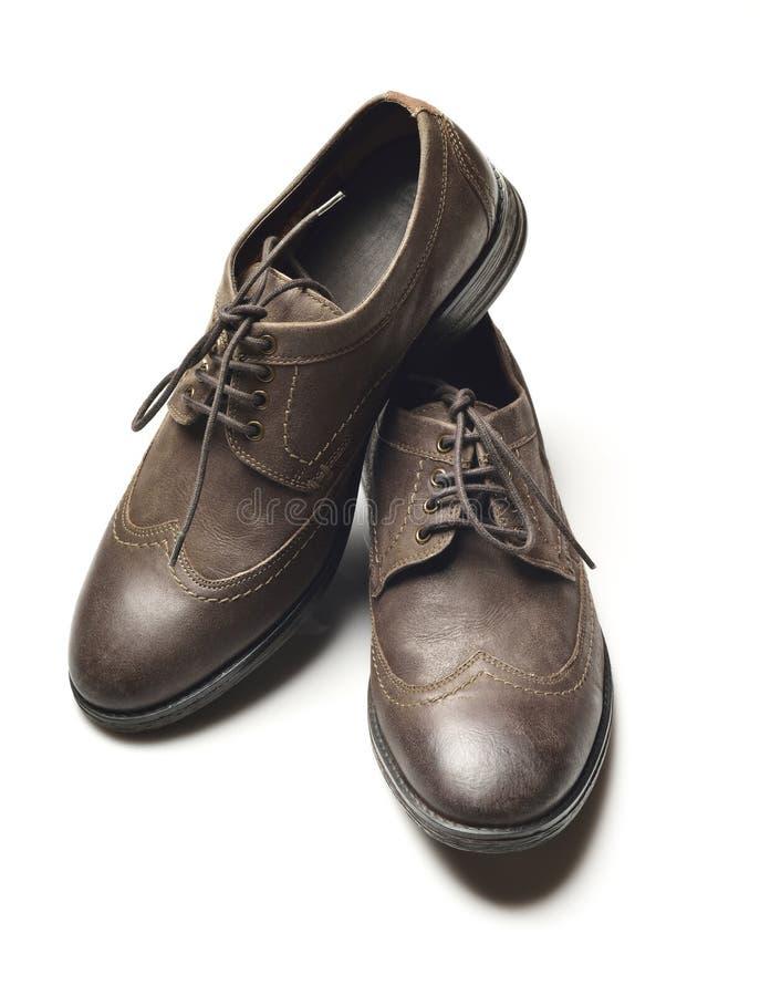 Zapatos de cuero marrón oscuro imágenes de archivo libres de regalías