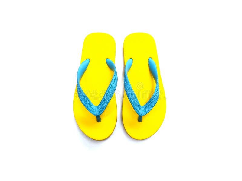 Zapatos de goma amarillos y azules de la chancleta foto de archivo