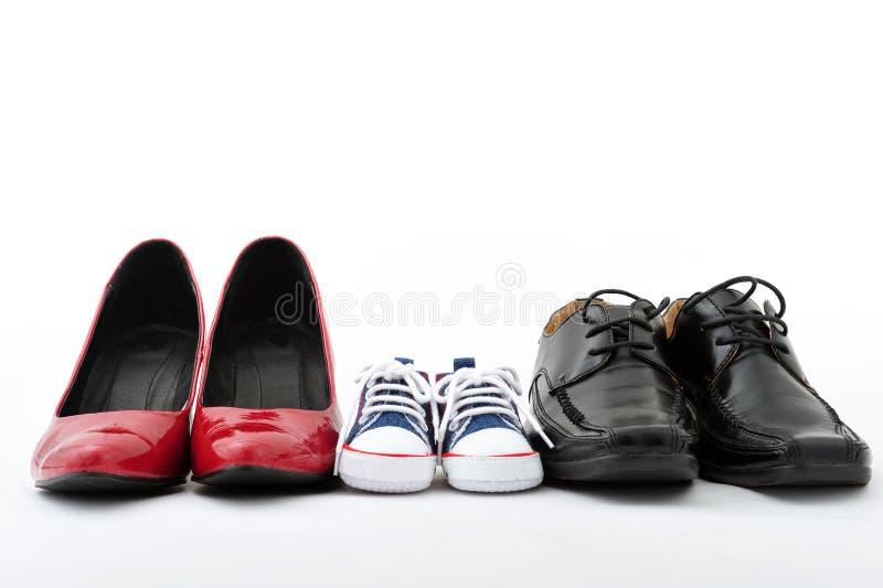 Zapatos de la familia imagenes de archivo