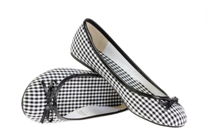 Zapatos de las muchachas en blanco. imagenes de archivo