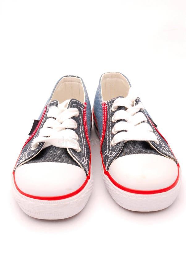 Zapatos de los cabritos foto de archivo