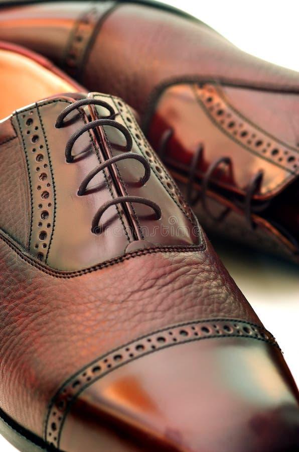 Zapatos de los hombres imagenes de archivo