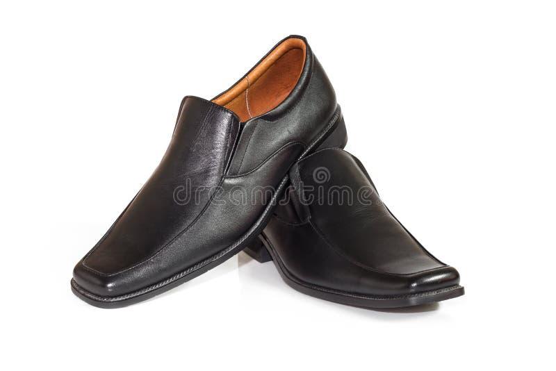 Zapatos de los hombres en el fondo blanco fotografía de archivo