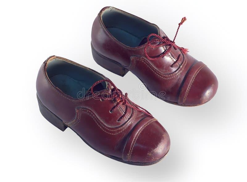 Zapatos de los niños antiguos imagen de archivo