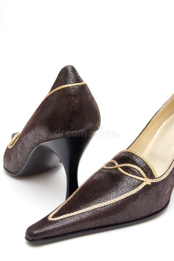 Zapatos de Womans en un fondo blanco fotografía de archivo libre de regalías