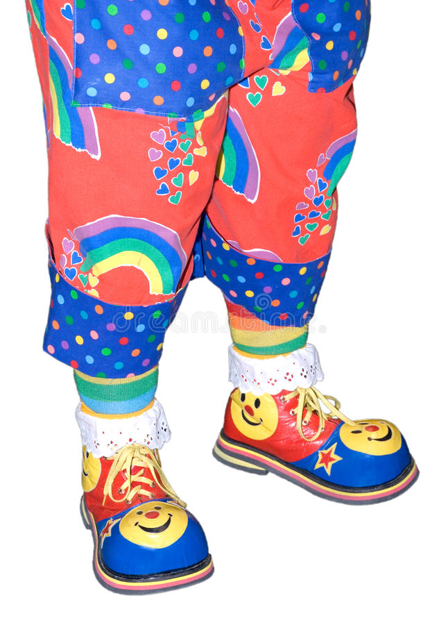 Zapatos del payaso de circo y detalle aislado pantalones imagen de archivo libre de regalías