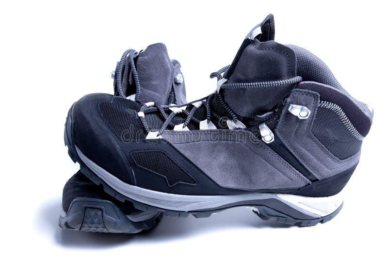 Zapatos del senderismo aislados en el fondo blanco Botas del deporte para caminar de la montaña imagen de archivo libre de regalías