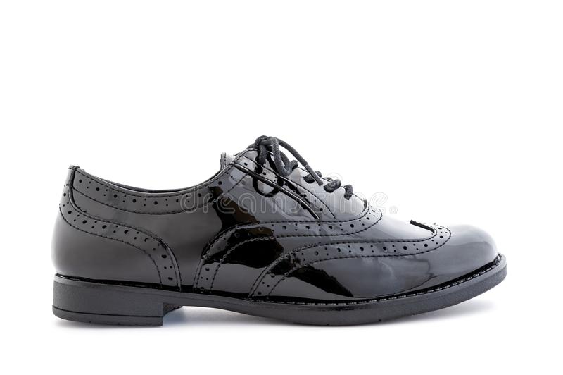 Zapatos elegantes de las mujeres negras aislados en el fondo blanco imagenes de archivo