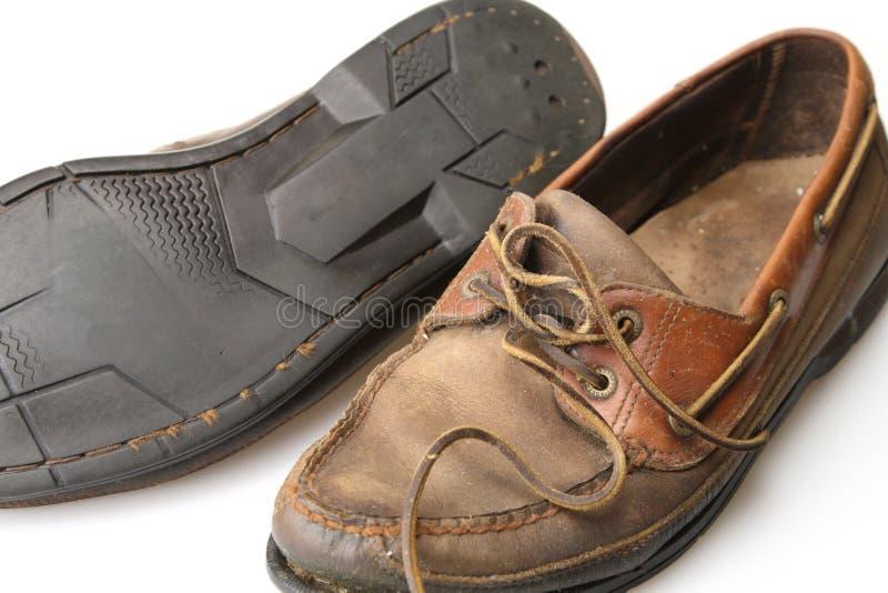 Zapatos gastados fotografía de archivo
