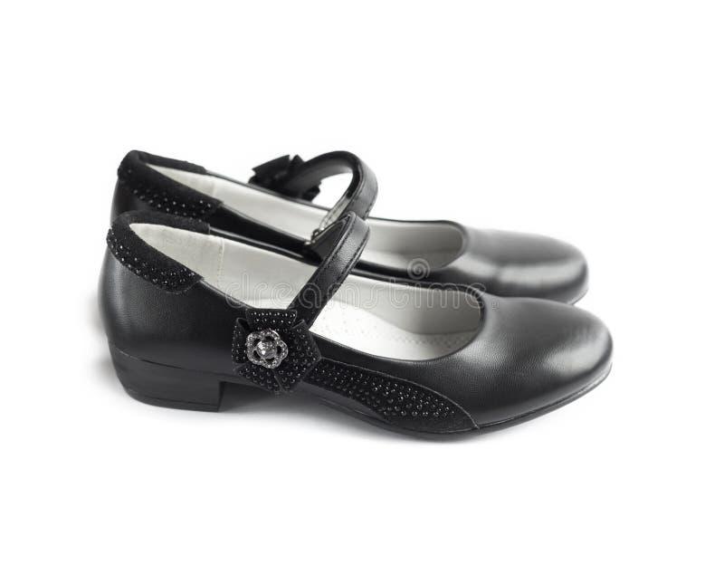 Zapatos hermosos negros para la muchacha fotos de archivo libres de regalías