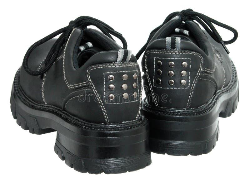 Zapatos negros del invierno de las mujeres (posteriores) foto de archivo libre de regalías