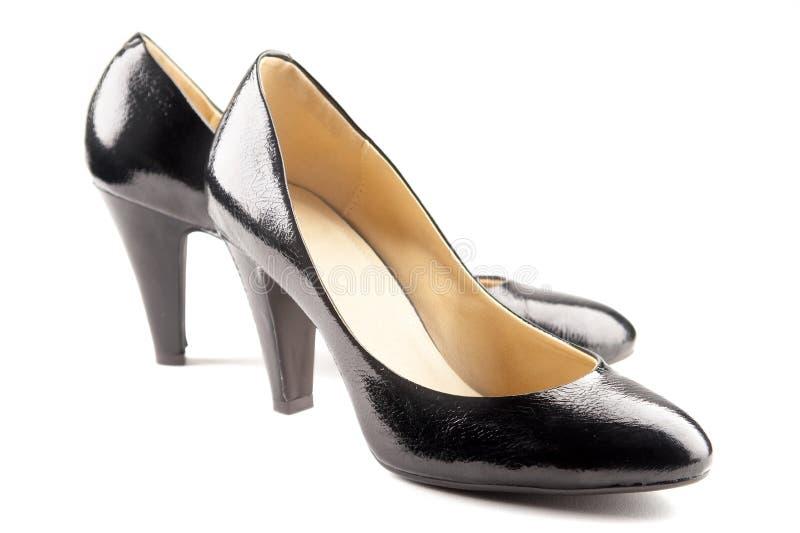 Zapatos negros del patente-cuero imagenes de archivo