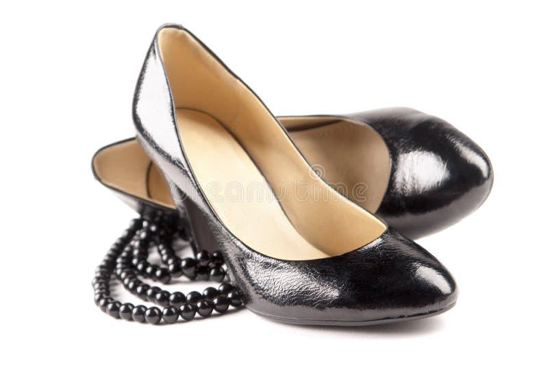 Zapatos negros del patente-cuero fotos de archivo