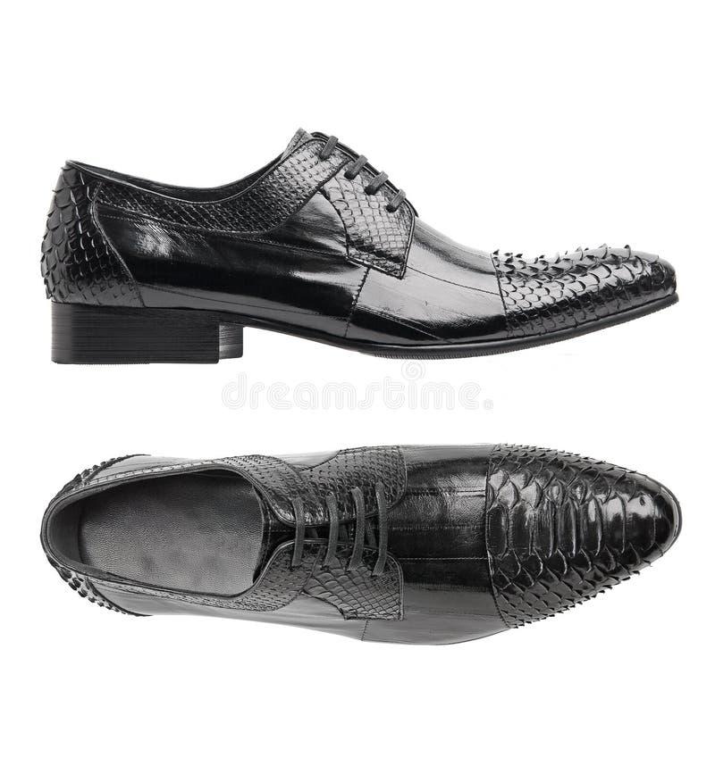 Zapatos negros del varón del cuero de patente imágenes de archivo libres de regalías