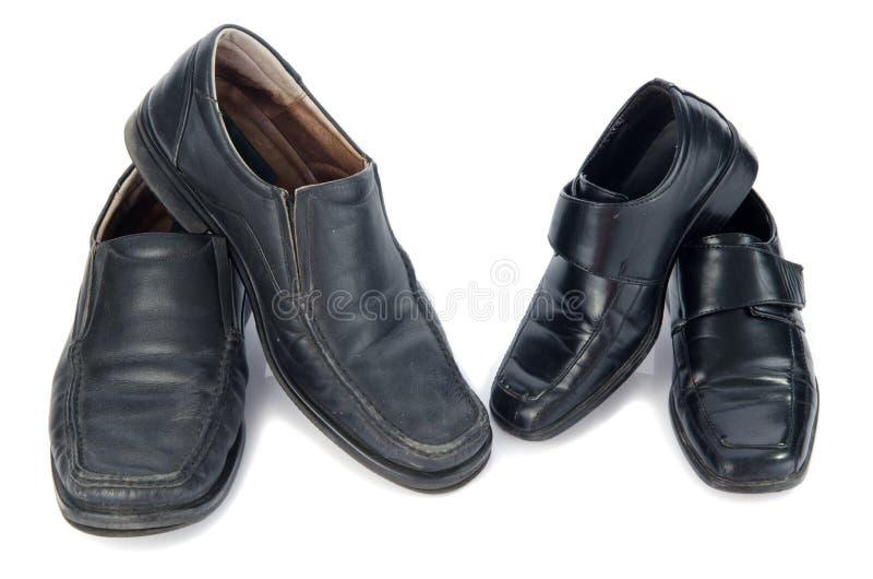 Zapatos negros viejos fotografía de archivo libre de regalías