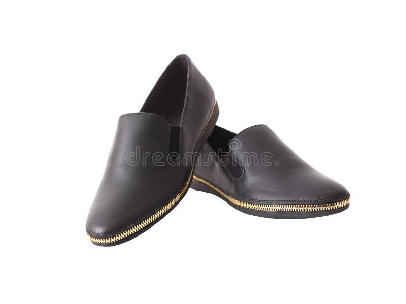 Zapatos para un hombre joven imagenes de archivo