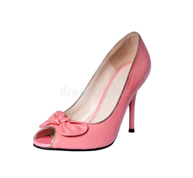 Zapatos rosados aislados en un fondo blanco imagen de archivo