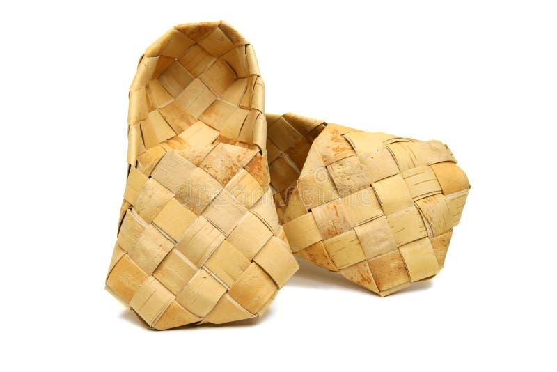 Zapatos rusos viejos de la estopa Lapty nombrada calzado imagen de archivo