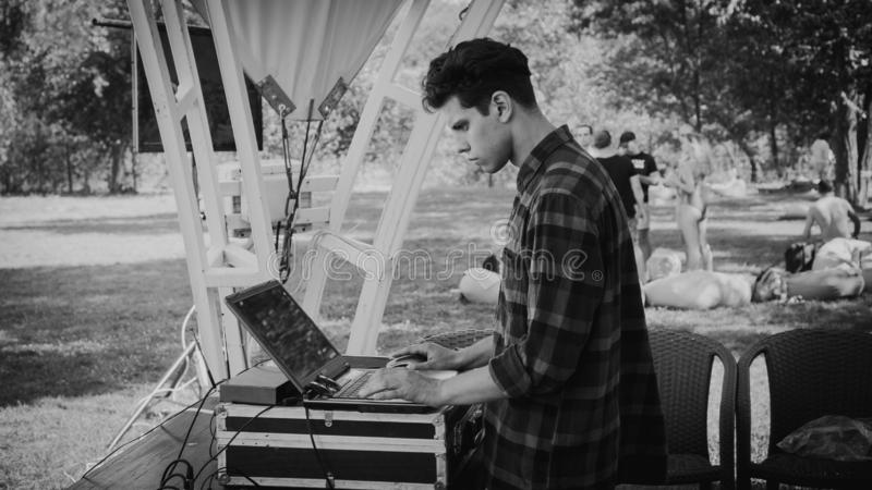 Zaporizhia, Ukraine-August 2018: a pool party in the company ovoh. DJ is focused and picks up music, the concept of stock photography