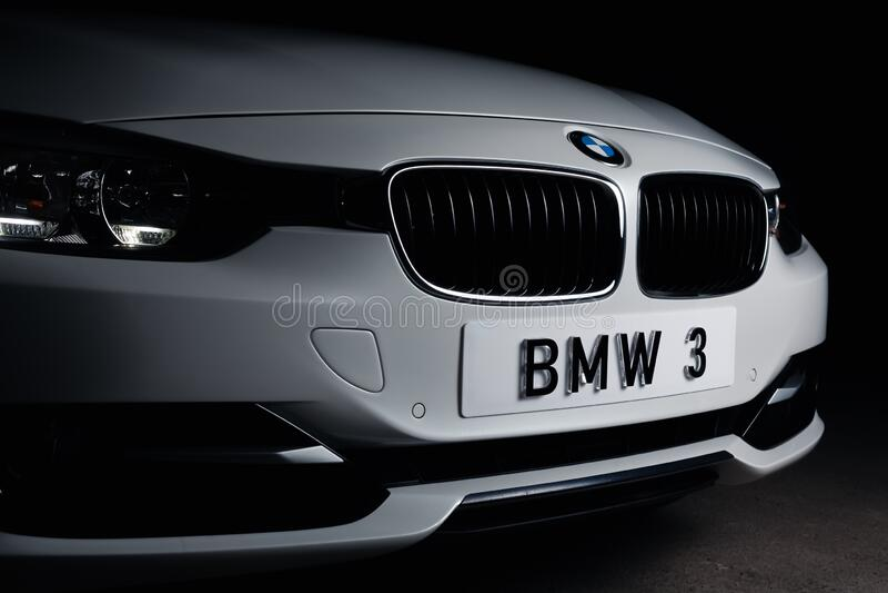 Zaporizhia, Ukraine, March 8, 2020. BMW 328i, white car close-up on a black background. Stock photos