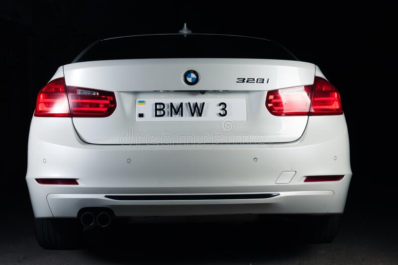 Zaporizhia, Ukraine, March 8, 2020. BMW 328i, white car close-up on a black background. Stock images