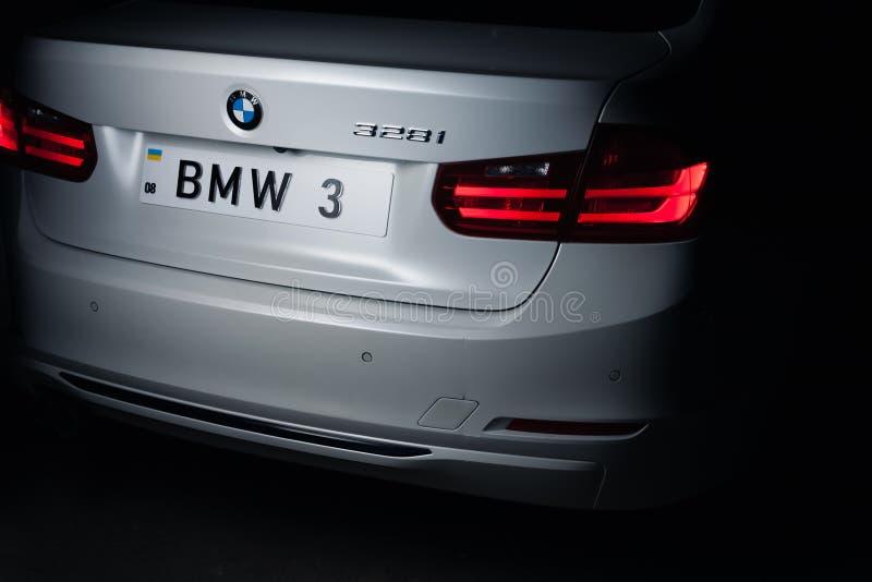 Zaporizhia, Ukraine, March 8, 2020. BMW 328i, white car close-up on a black background. Stock photo