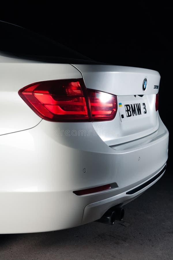 Zaporizhia, Ukraine, March 8, 2020. BMW 328i, white car close-up on a black background. Stock photography