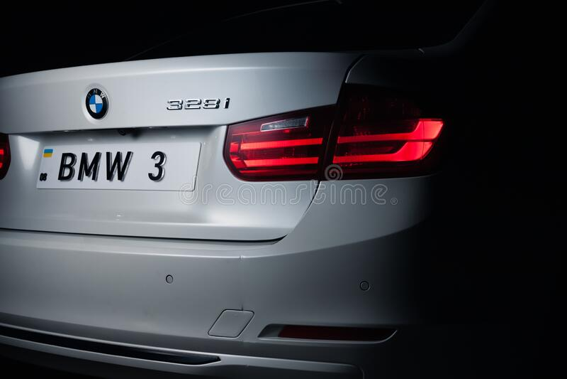Zaporizhia, Ukraine, March 8, 2020. BMW 328i, white car close-up on a black background. Royalty free stock photography