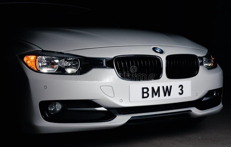 Zaporizhia, Ukraine, March 8, 2020. BMW 328i, white car close-up on a black background. Royalty free stock photos