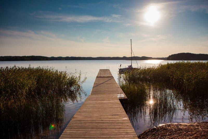 Zarasas lake, Zarasai, Lithuania. Zarasas lake with a pier and boat in Zarasai town, Lithuania royalty free stock images