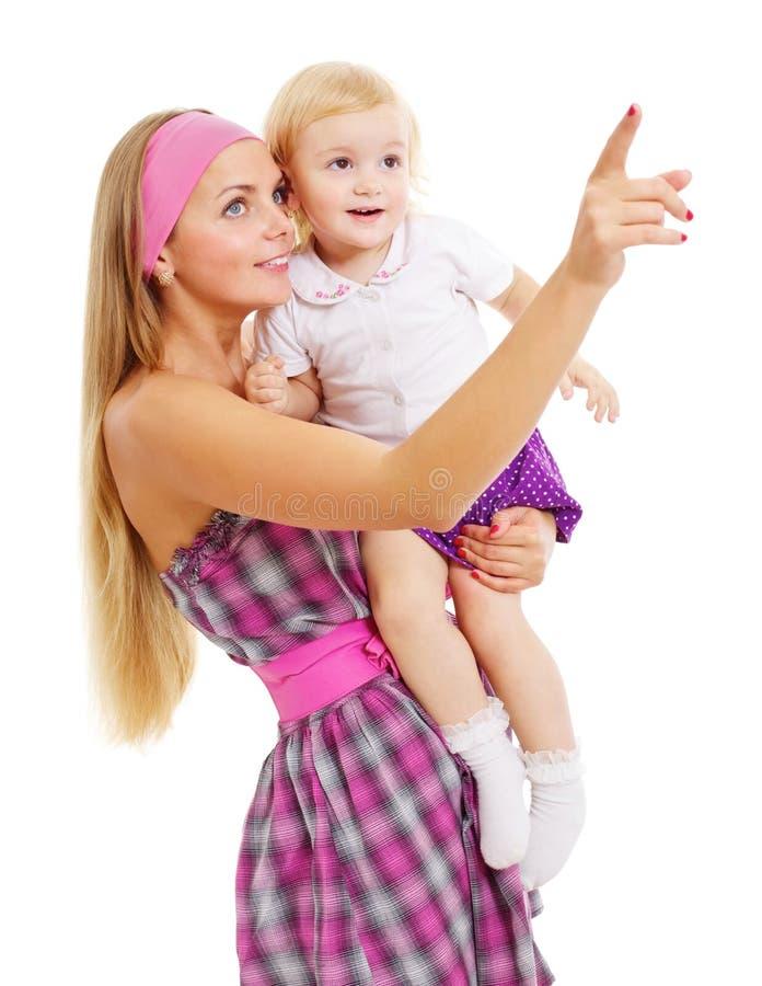 zaskakująca przyglądająca dziecko naprzód matka zdjęcie stock