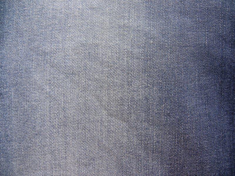Zatarty zmrok - niebiescy dżinsy tło obraz stock