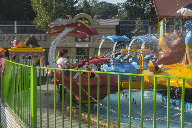 Zatorland Poland. Carousel and playgrounds for the kids in thematic park with dinosaurs in Zator ,Poland near Krakow stock photo