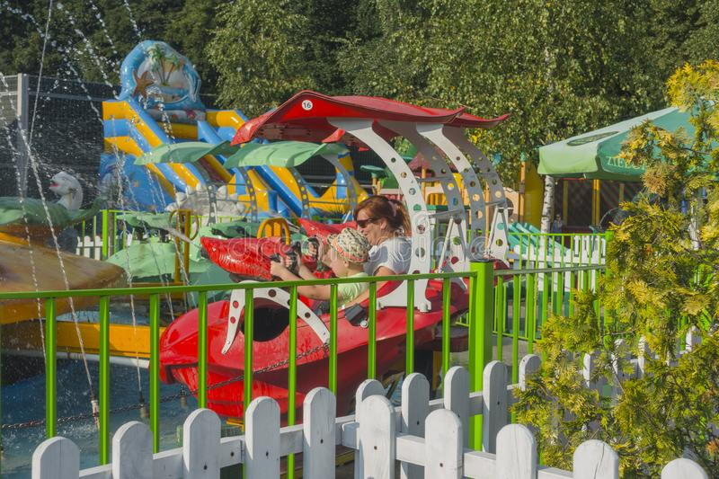 Zatorland Poland. Carousel and playgrounds for the kids in thematic park with dinosaurs in Zator ,Poland near Krakow stock images