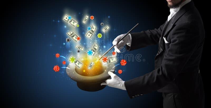 Zauberkünstler beschwören Glück von einem Zylinder lizenzfreies stockfoto