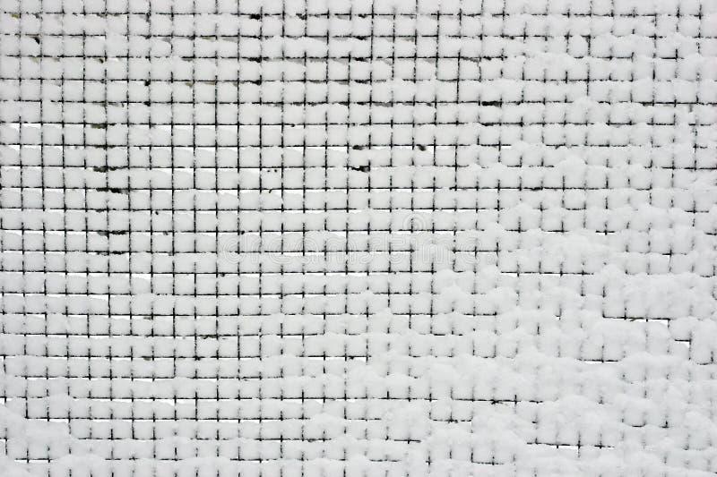 Zaun mit Schnee lizenzfreie stockbilder