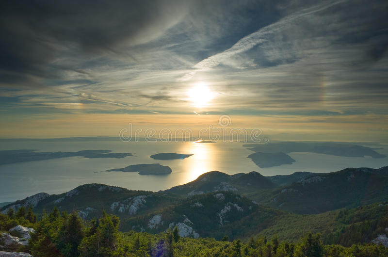 Zavizan. A couple a days ago I was sitting all by myself philosophizing at the top of the mountain Zavizan in Croatia. It was a magical moment and a stunning stock images
