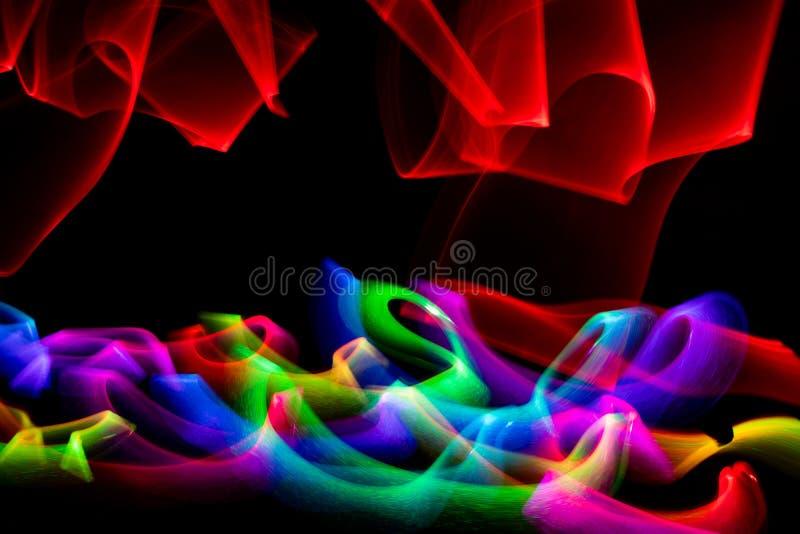 Zawijas barwioni światła przeciw czarnemu tłu fotografia royalty free