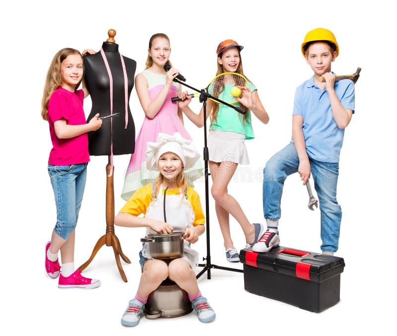 Zawodu i pracy zajęcie, dziecko grupa w Fachowych kostiumach, dzieciaki na bielu fotografia stock