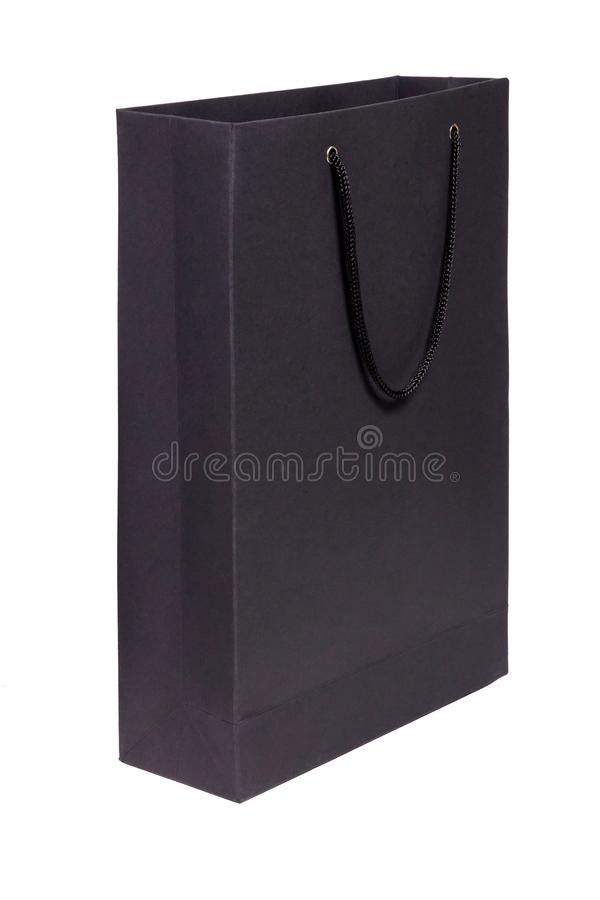 Zbliżenia czerni papieru pusty pakunek z rękojeściami odizolowywać na białym tle Pojęcie handel detaliczny, zakupy, elegancki lak zdjęcie stock