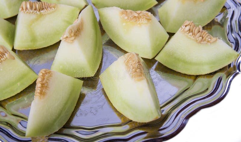 Zbliżenie świezi plasterki żółty melon lub kantalup na starym zdjęcie royalty free