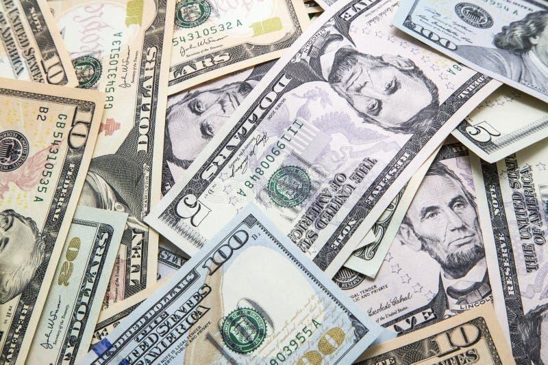 Zbliżenie amerykanina gotówki kolorowi rachunki obraz stock