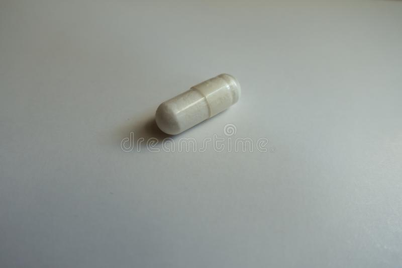 Zbliżenie biała kapsuła magnezu cytrynian zdjęcia stock