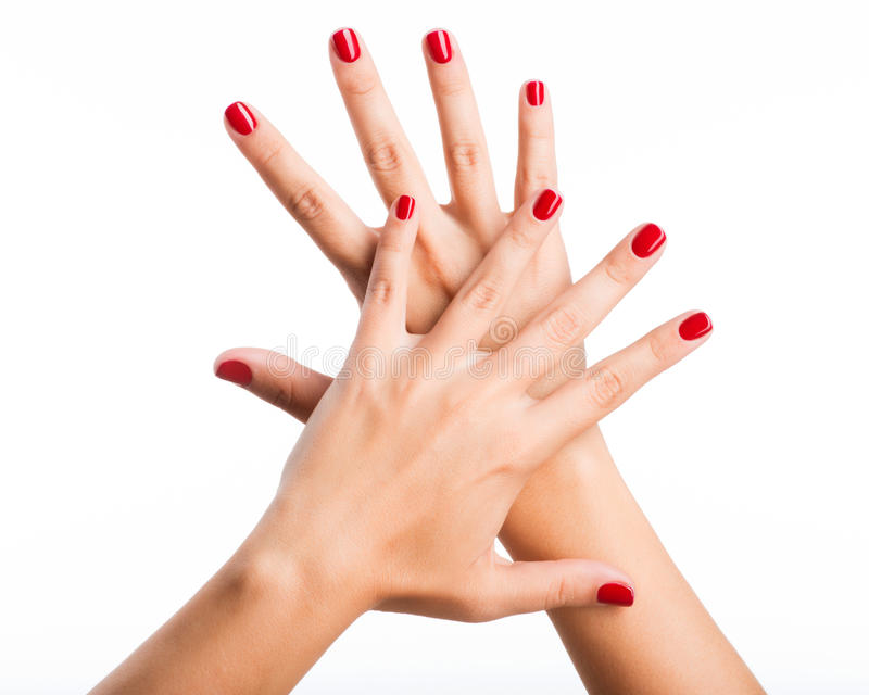 Zbliżenie fotografia kobiety ręki z czerwonymi gwoździami obrazy stock
