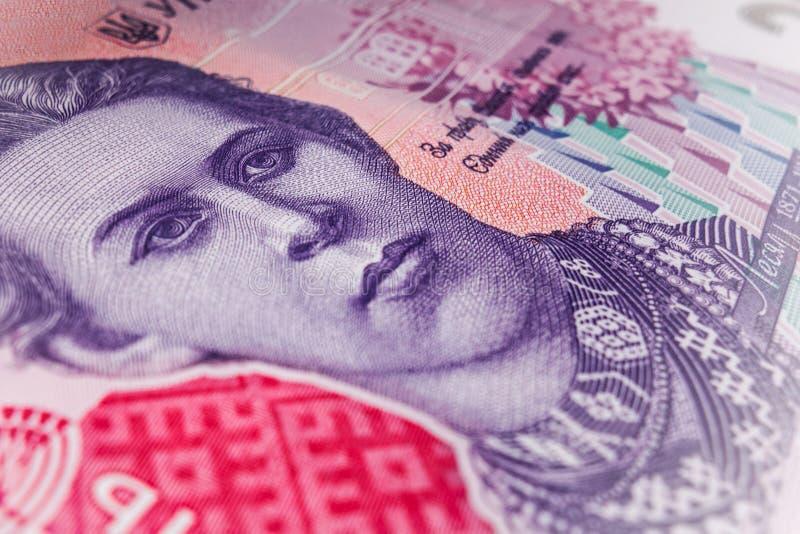 Zbliżenie makro- czerep Ukraiński banknotu pieniądze 200 hrivna Portret krajowa poetka Lesya Ukrainka Częsciowo zamazany obrazy stock