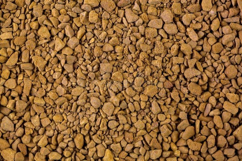 Zbliżenie natychmiastowa kawa Granuli soluble złota piec kawa obrazy stock