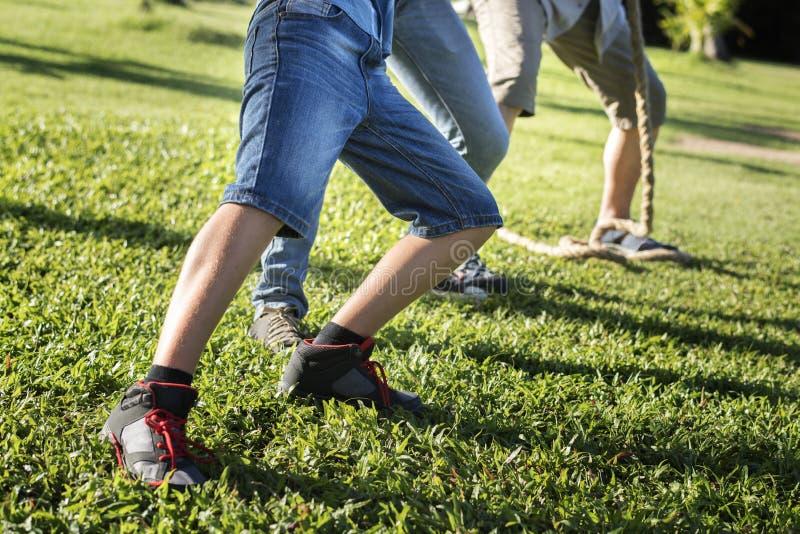 Zbliżenie nogi bawić się futbol rodzina zdjęcie stock